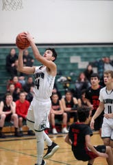Klahowya's John Hartford goes to the basket during a game against Chief Kitsap in January.