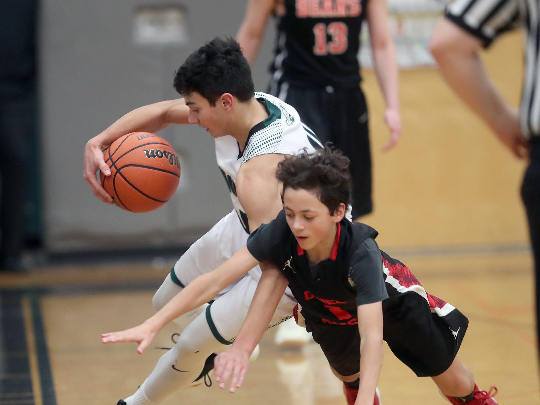 Klahowya player Jacob Kraft steals the ball away from Chief Kitsap Academy player Christian Wion-Rathburn in a boys basketball at Klahowya on Tuesday, January, 22, 2019.