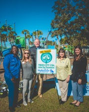Tthe new sign commemorating the City of Melbourne's 30th year of being a Tree City USA was unveiled. Pictured from left to right are Council Member Yvonne Minus; Vice Mayor Debbie Thomas; Director of Parks, Recreation and Golf Kevin Briski; Mayor Kathy Meehan; and City Manager Shannon Lewis.
