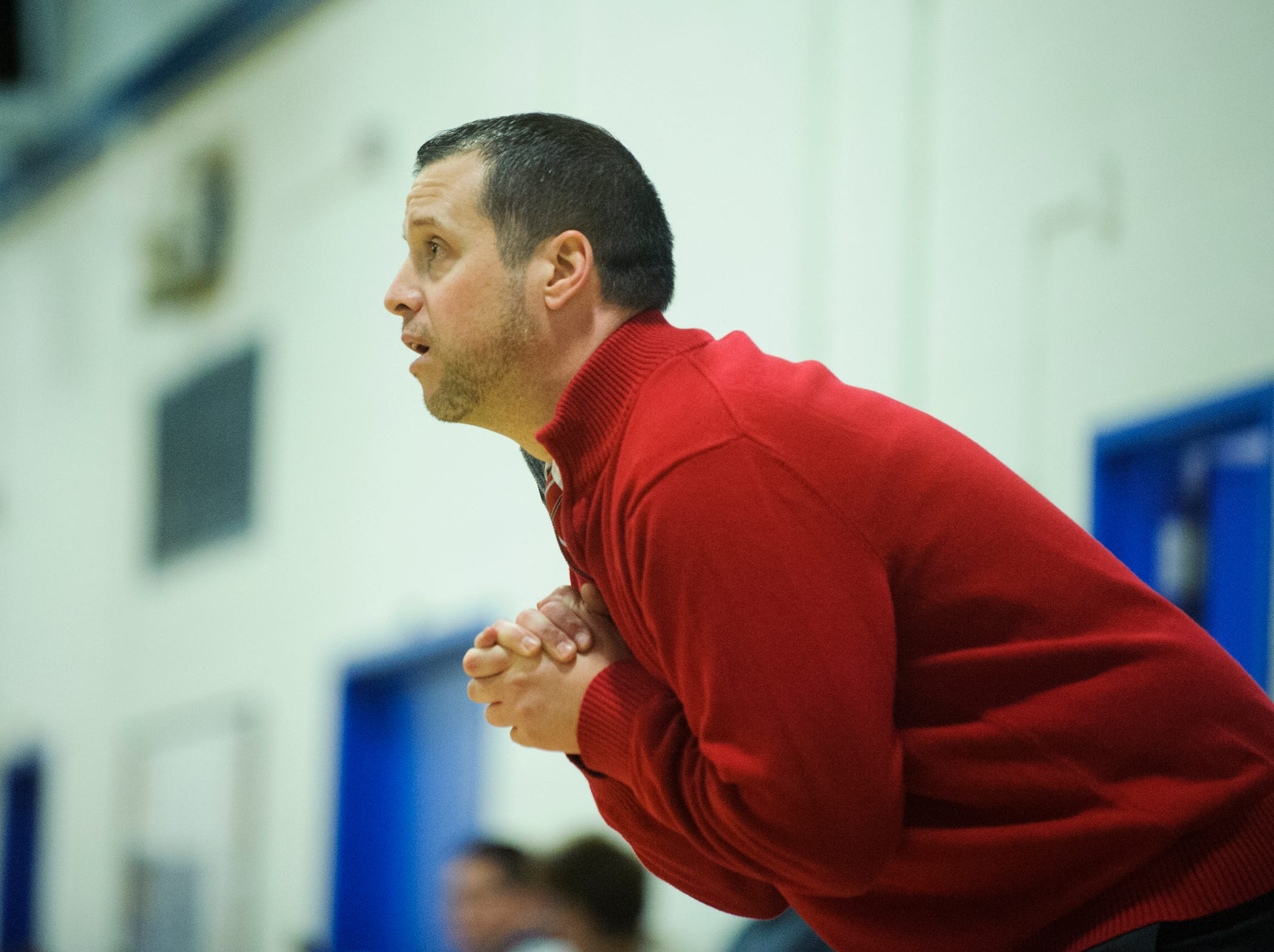 CVU head coach Michael Osborne watches the action on the court during the boys basketball game between the Champlain Valley Union Redhawks and the Mount Mansfield Cougars at MMU High School on Tuesday night January 22, 2019 in Jericho.