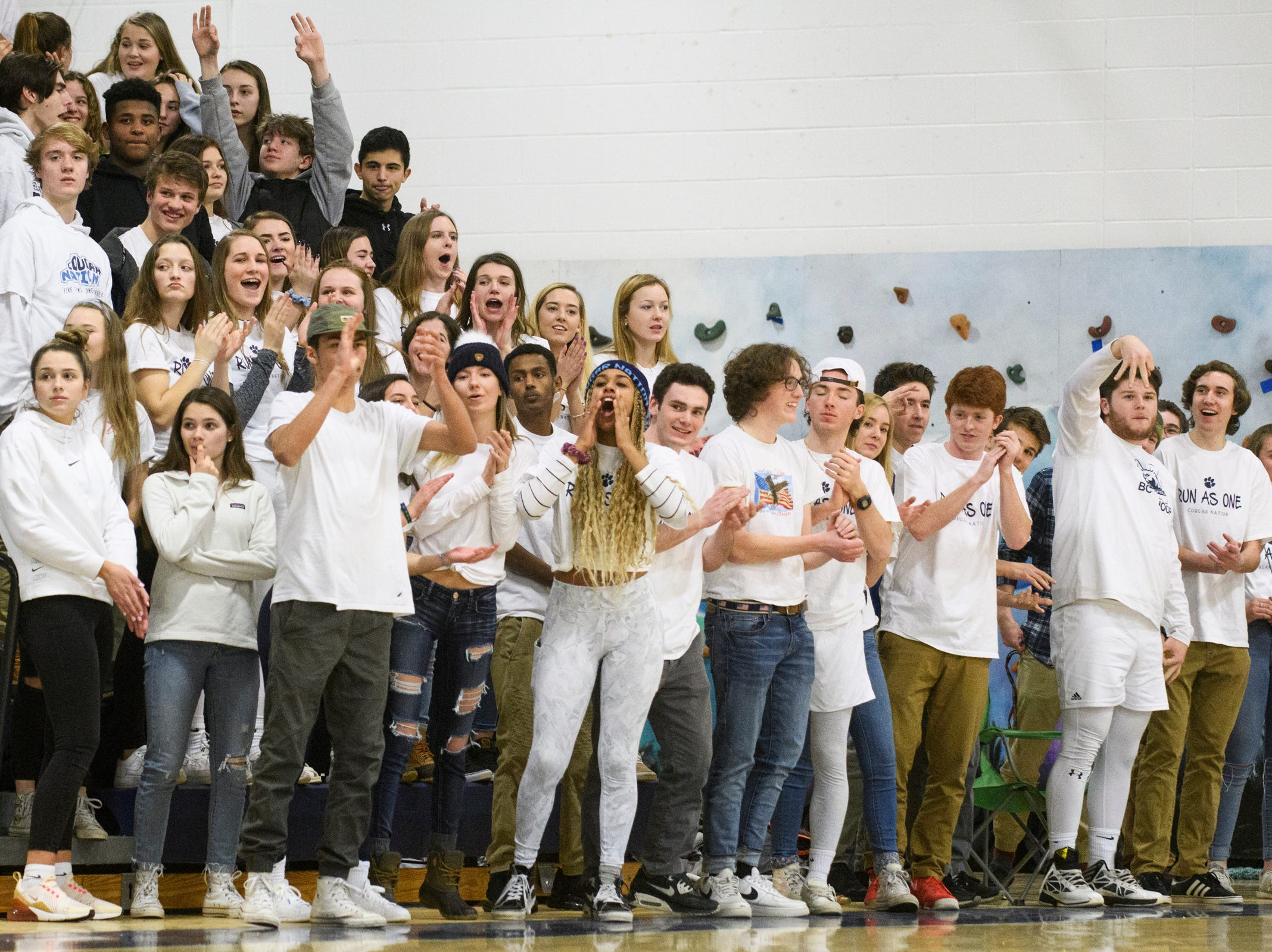 MMU fans cheer for the team during the boys basketball game between the Champlain Valley Union Redhawks and the Mount Mansfield Cougars at MMU High School on Tuesday night January 22, 2019 in Jericho.