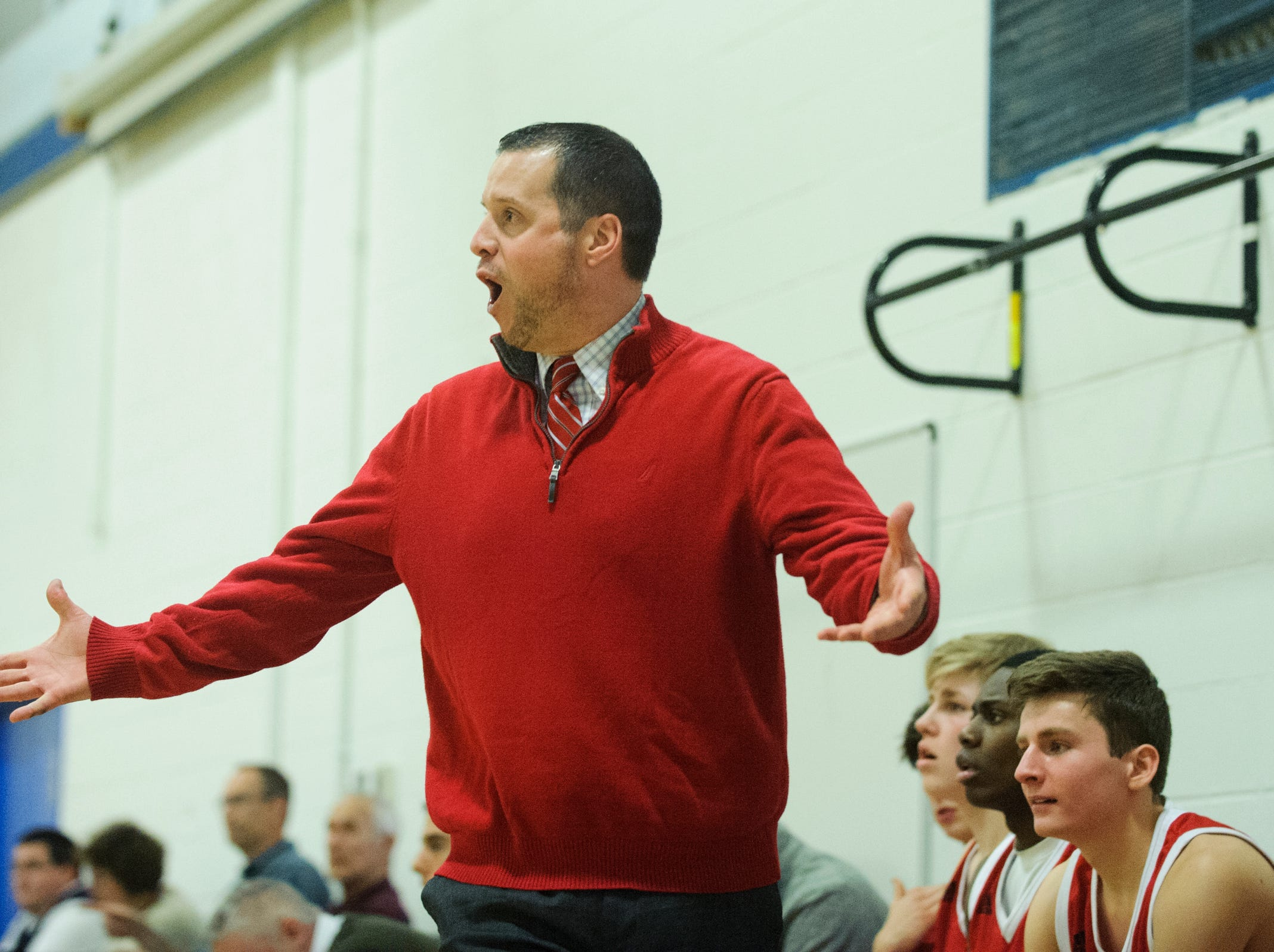 CVU head coach Michael Osborne reacts to a call on the court during the boys basketball game between the Champlain Valley Union Redhawks and the Mount Mansfield Cougars at MMU High School on Tuesday night January 22, 2019 in Jericho.