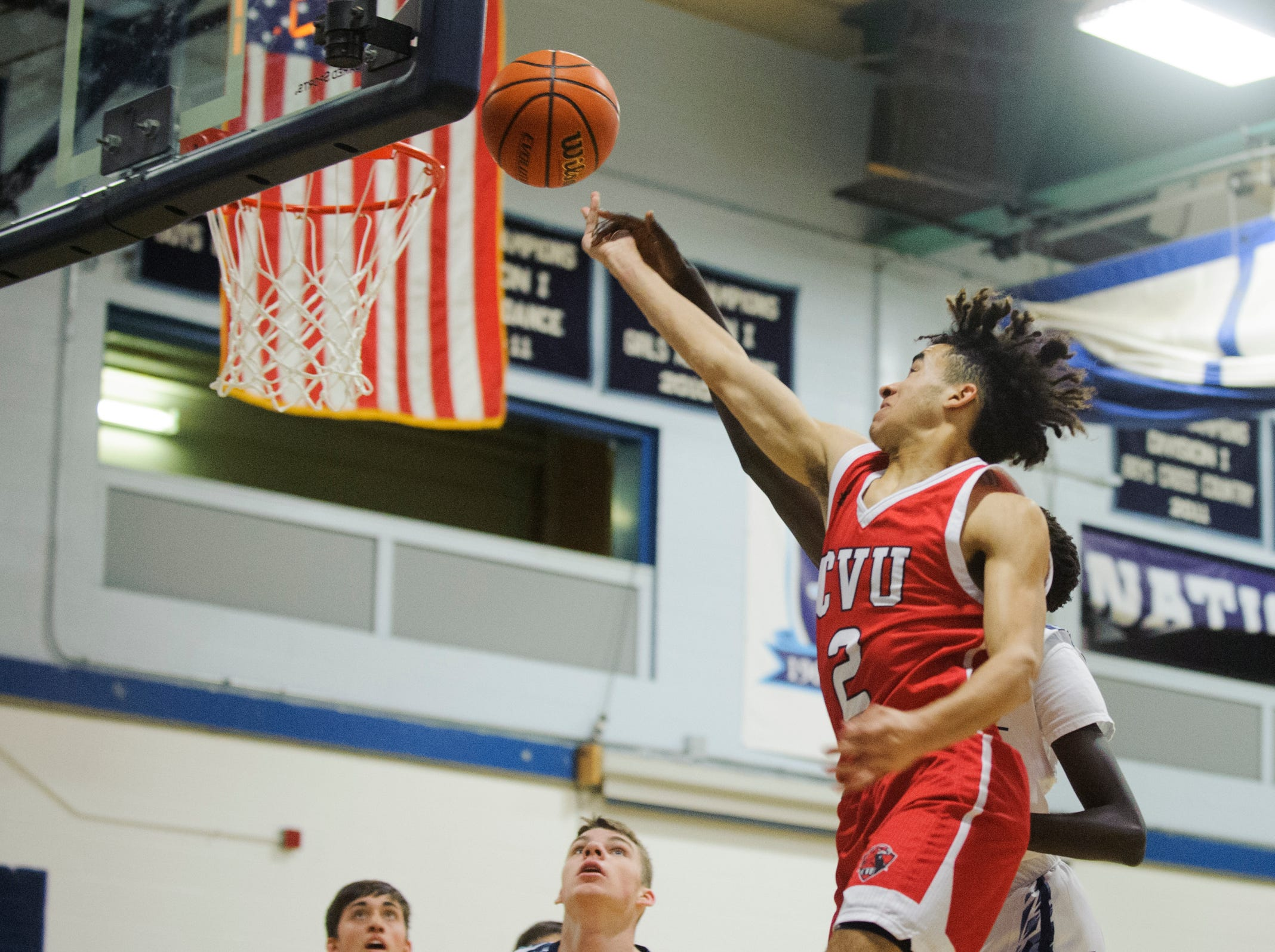 CVU's Jason West (2) leaps for a lay up during the boys basketball game between the Champlain Valley Union Redhawks and the Mount Mansfield Cougars at MMU High School on Tuesday night January 22, 2019 in Jericho.