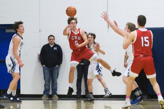 CVU's Ethan Harvey (5) saves the ball from going out of bounds during the boys basketball game between the Champlain Valley Union Redhawks and the Mount Mansfield Cougars at MMU High School on Tuesday night January 22, 2019 in Jericho.