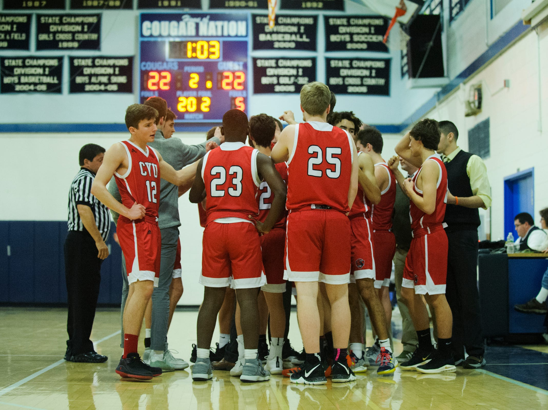 CVU huddles together during the boys basketball game between the Champlain Valley Union Redhawks and the Mount Mansfield Cougars at MMU High School on Tuesday night January 22, 2019 in Jericho.