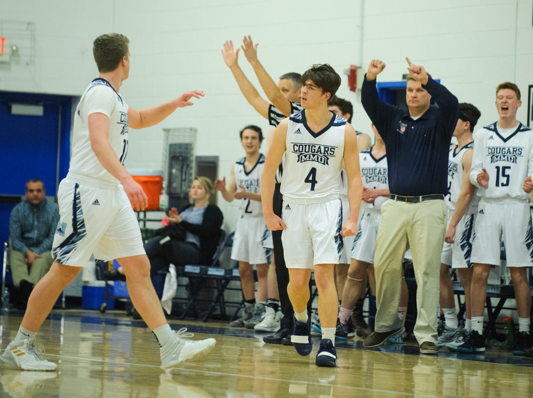 MMU celebrates a three poointer during the boys basketball game between the Champlain Valley Union Redhawks and the Mount Mansfield Cougars at MMU High School on Tuesday night January 22, 2019 in Jericho.