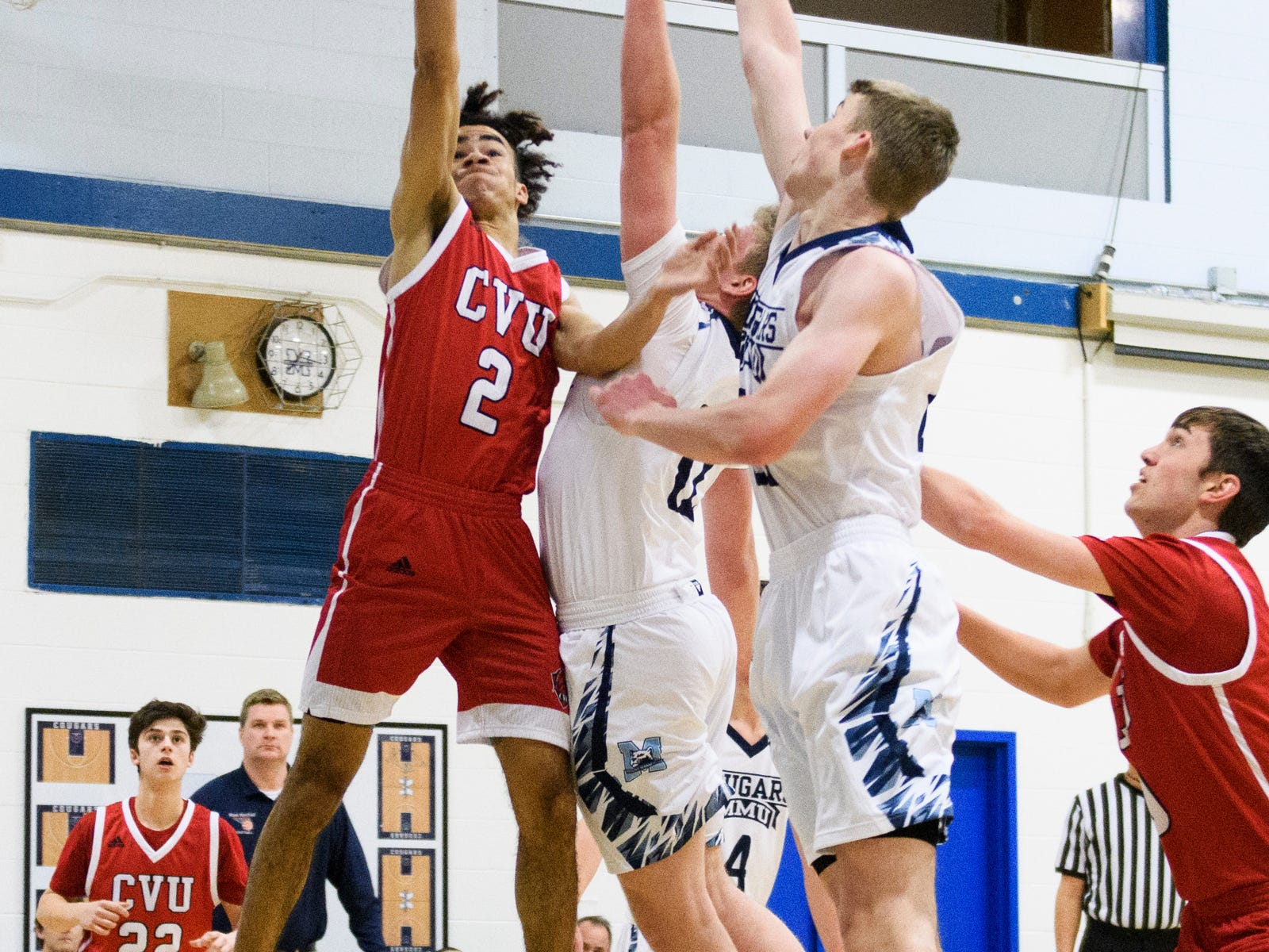CVU's Noah Martin (2) leaps for a lay up during the boys basketball game between the Champlain Valley Union Redhawks and the Mount Mansfield Cougars at MMU High School on Tuesday night January 22, 2019 in Jericho.