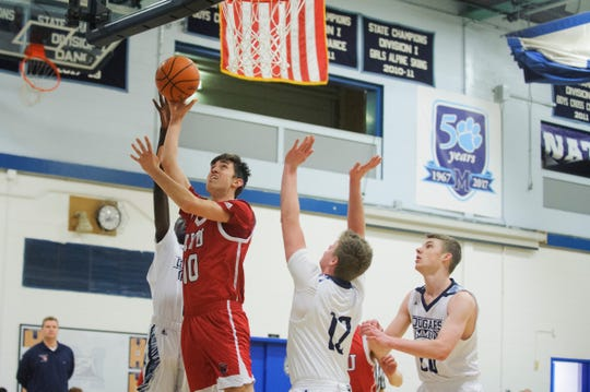 CVU's Noah Allen (10) leaps for a lay up during the boys basketball game between the Champlain Valley Union Redhawks and the Mount Mansfield Cougars at MMU High School on Tuesday night January 22, 2019 in Jericho.