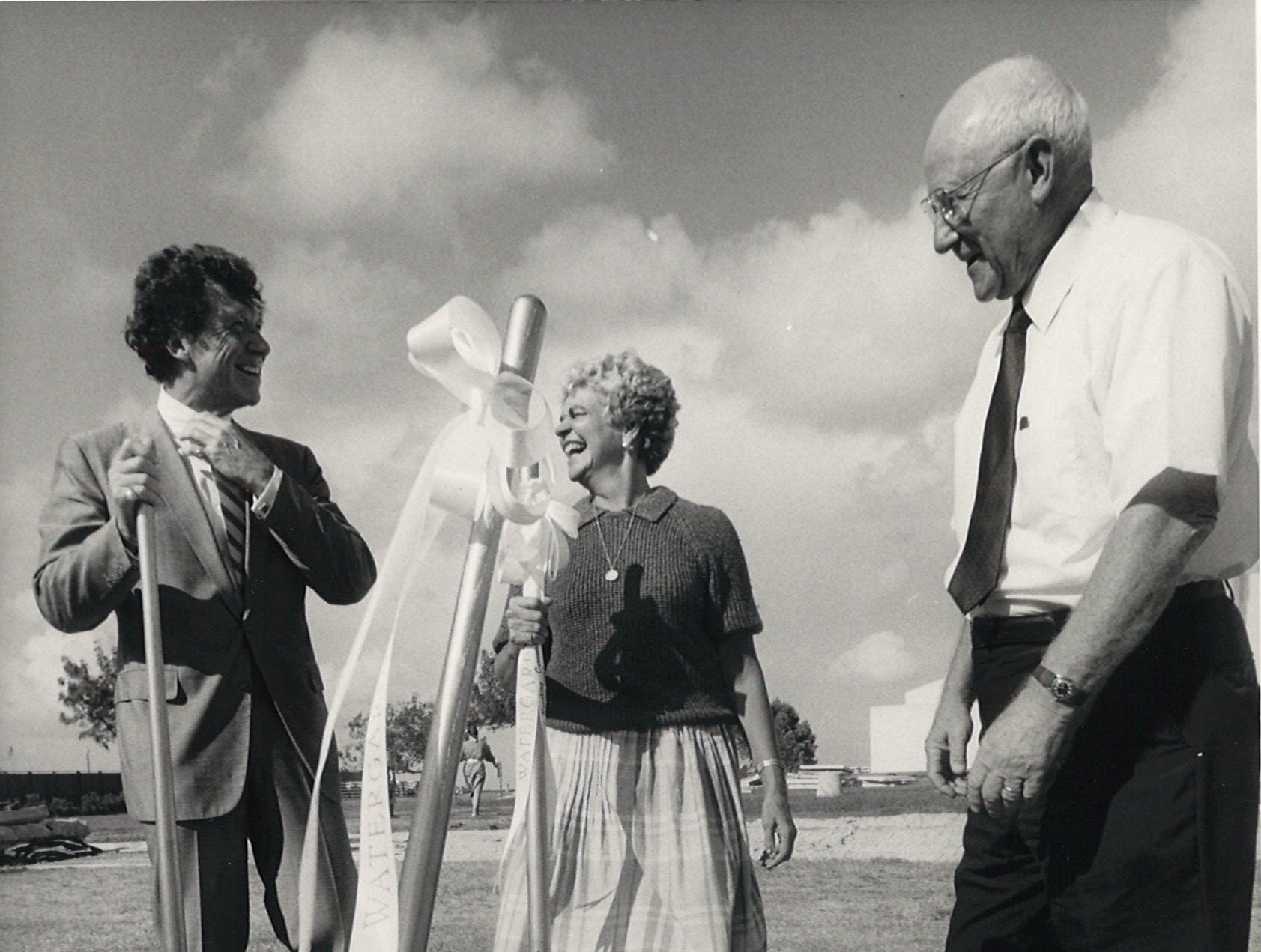 Jim Peterson, (left to right), president of the Foundation of Sciences and Arts, Corpus Christi Mayor Betty Turner and former Mayor Luther Jones chat after the groundbreaking ceremony at the Corpus Christi Watergarden on July 23, 1987.