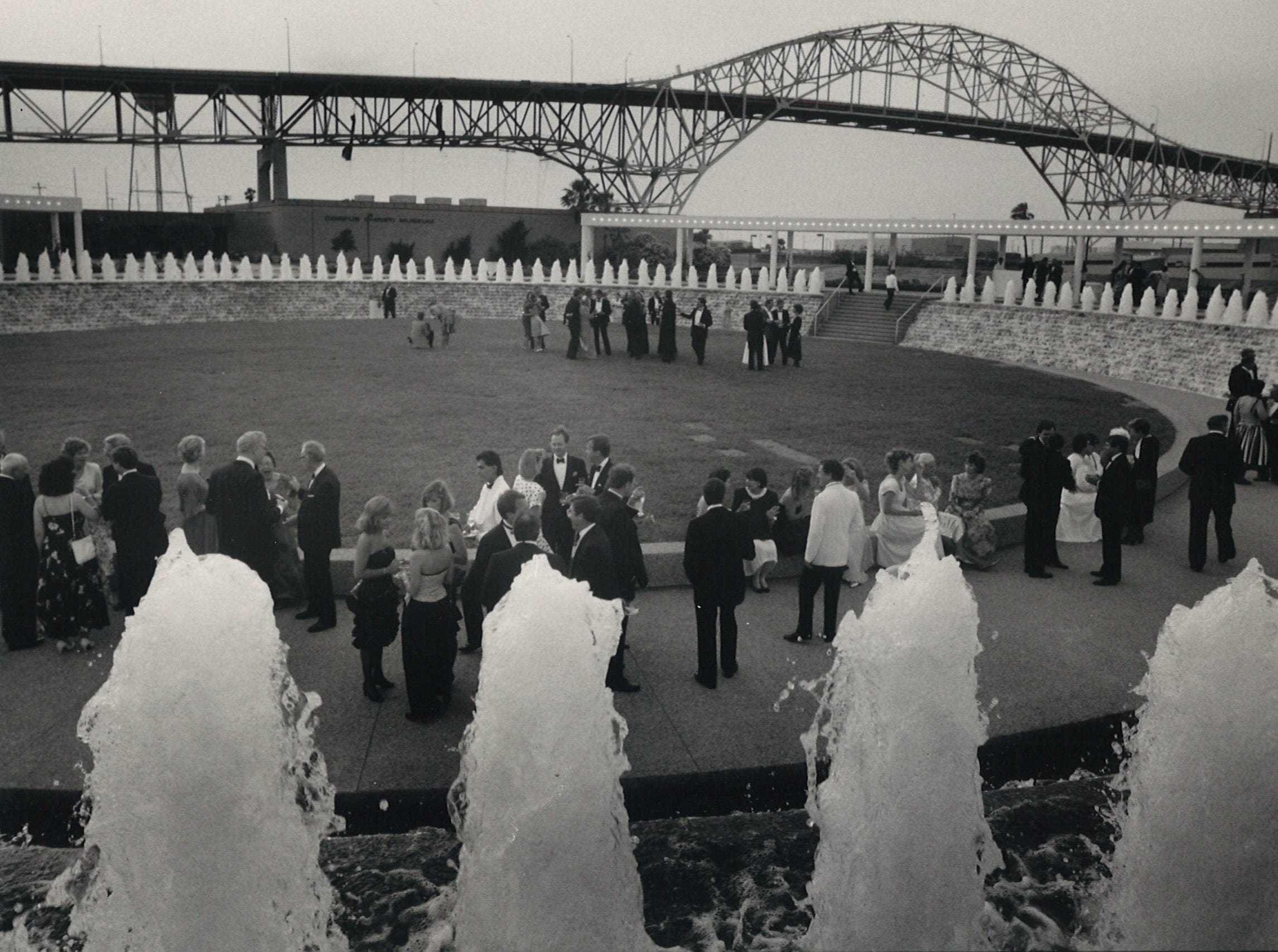 Partygoers mingle in the Corpus Christi Watergarden during the black tie opening gala on May 26, 1988.