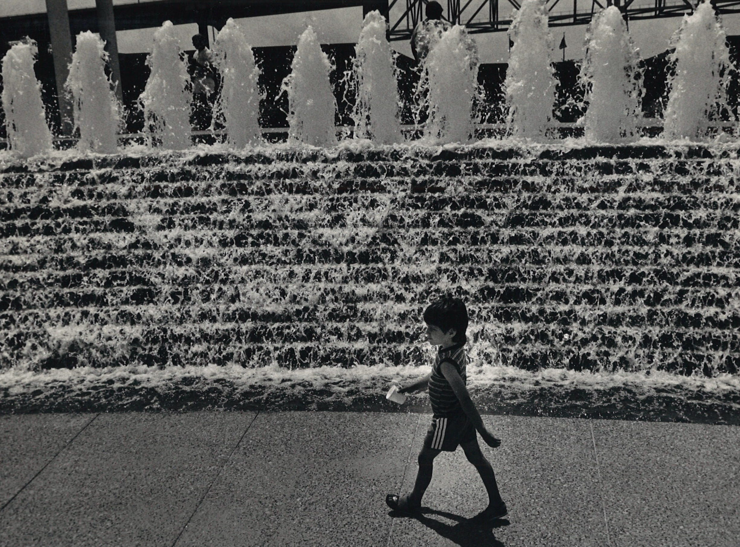 Water flows through the fountain at the Corpus Christi Watergarden as Calvin Hamilton, 6, walks by on June 14, 1988.