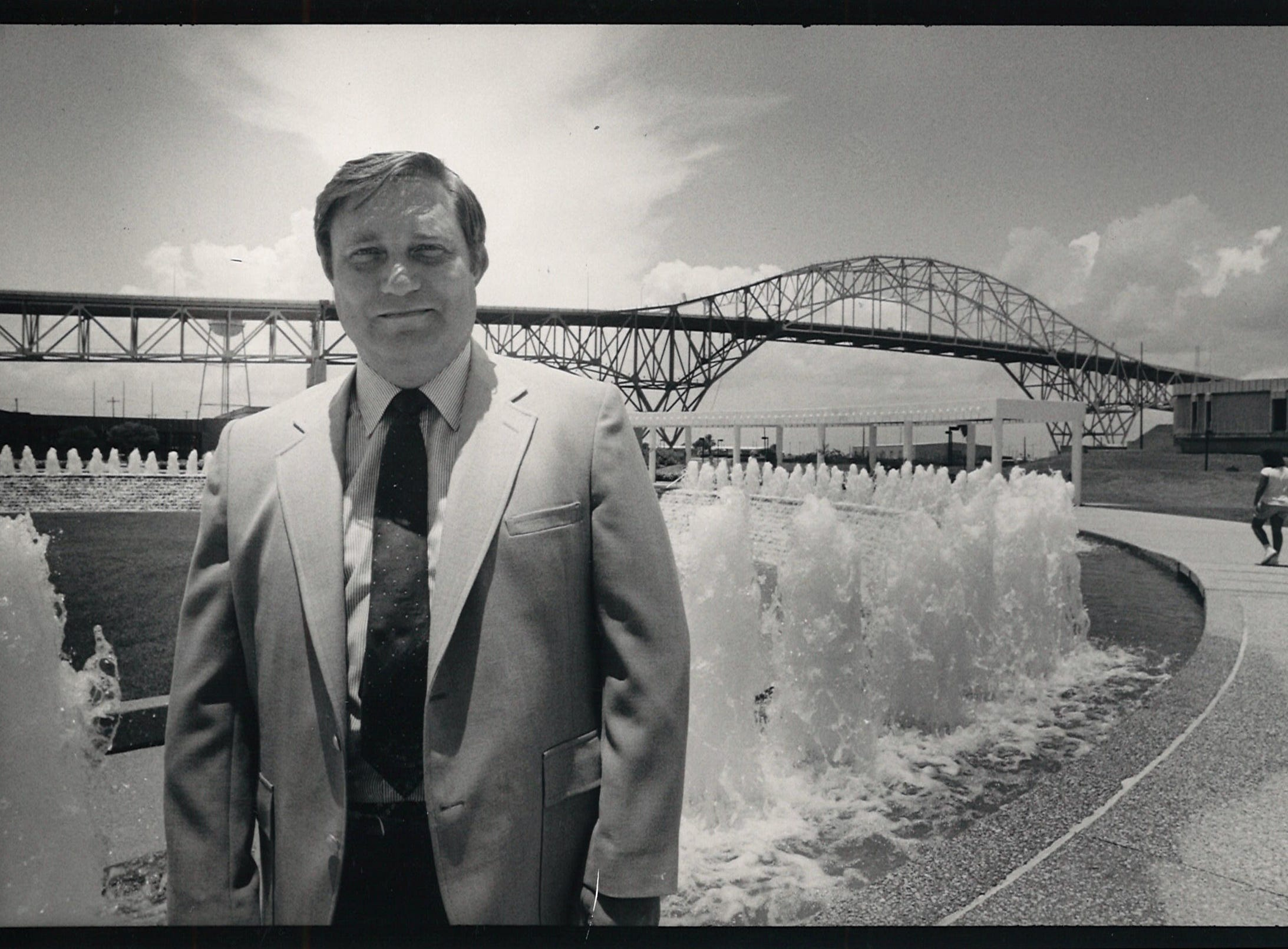 Bayfront Plaza Convention Center manager Hal Peterson stands in the Watergarden in July 1988.