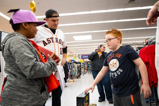 Astros's Max Stassi help kids shop at Academy Sports and Outdoors during the  Astros-Caravan stop on Wednesday, Jan. 23, 2019.