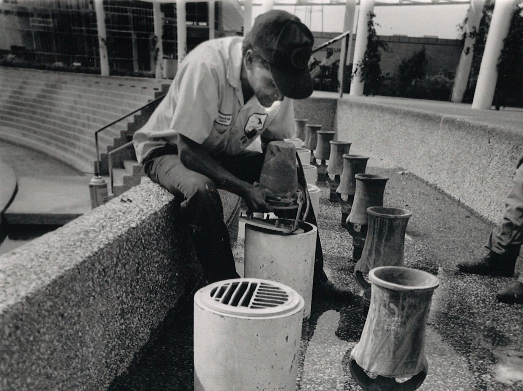 Alex Ronje, employee with the Bayfront Plaza Convention Center maintenance department, replaces one of the burnt-out bulbs in the lights that illuminate the Corpus Christi Watergarden in October 1989.