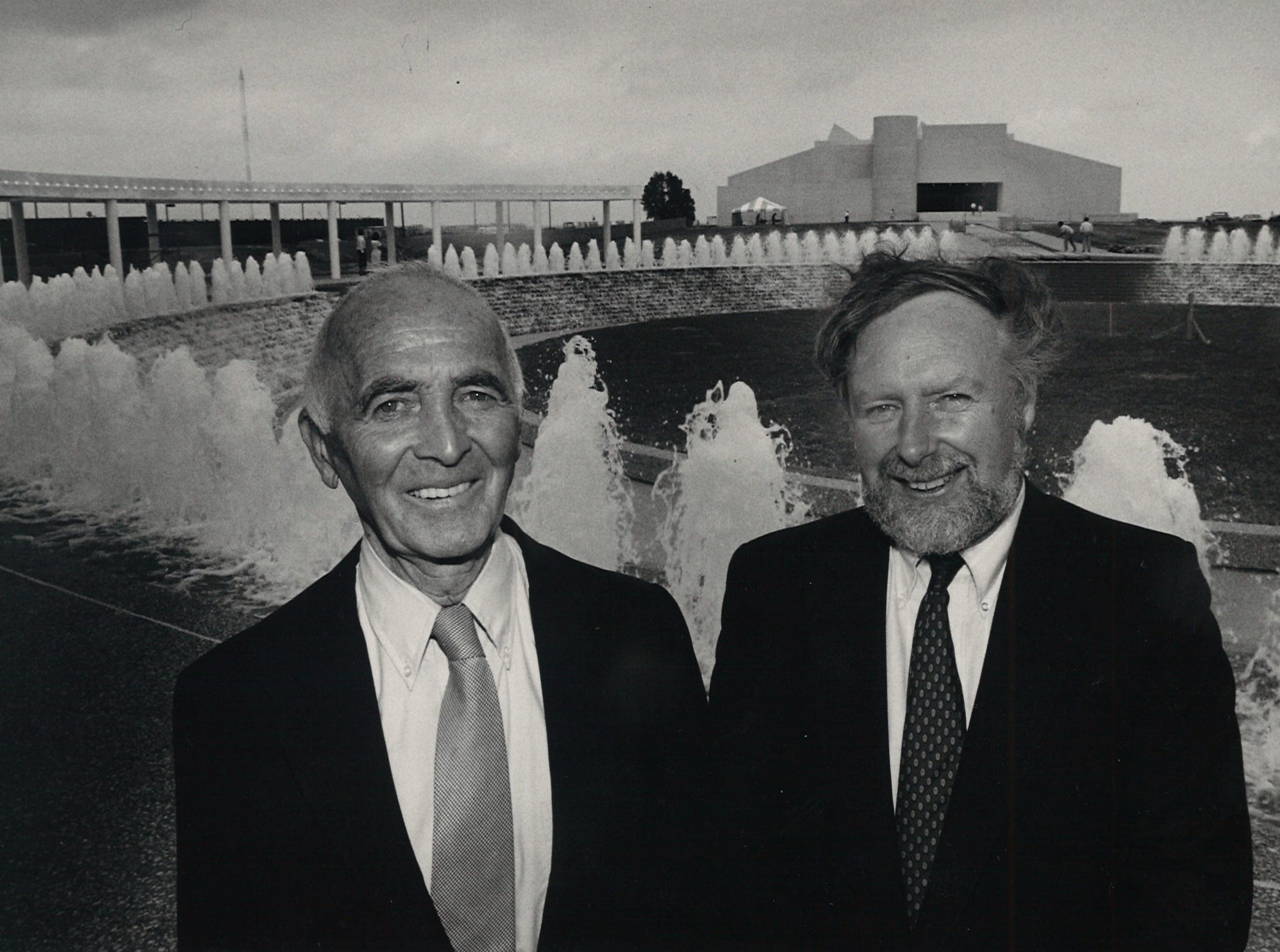 Robert Zion (left), architect of the Watergarden, and associate Donald C. Richardson (right), stand in front of the Watergarden May 12, 1988.