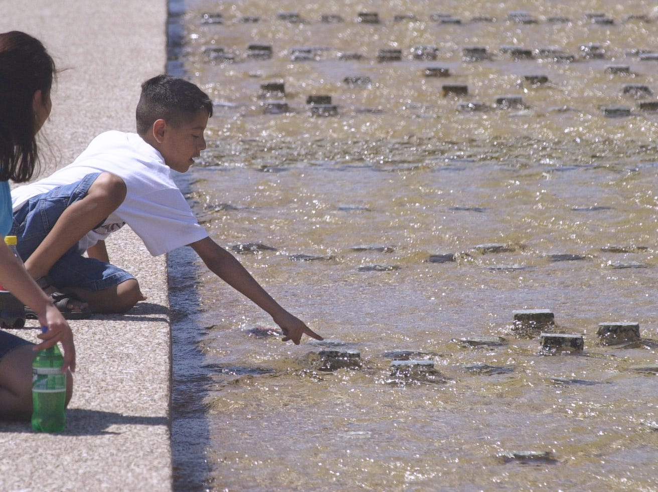 Dolores Gomez (left), from Sinton, decided to take her son, Javier Gomez, 7, to see the Corpus Christi Watergarden in March 2002 during his spring break.