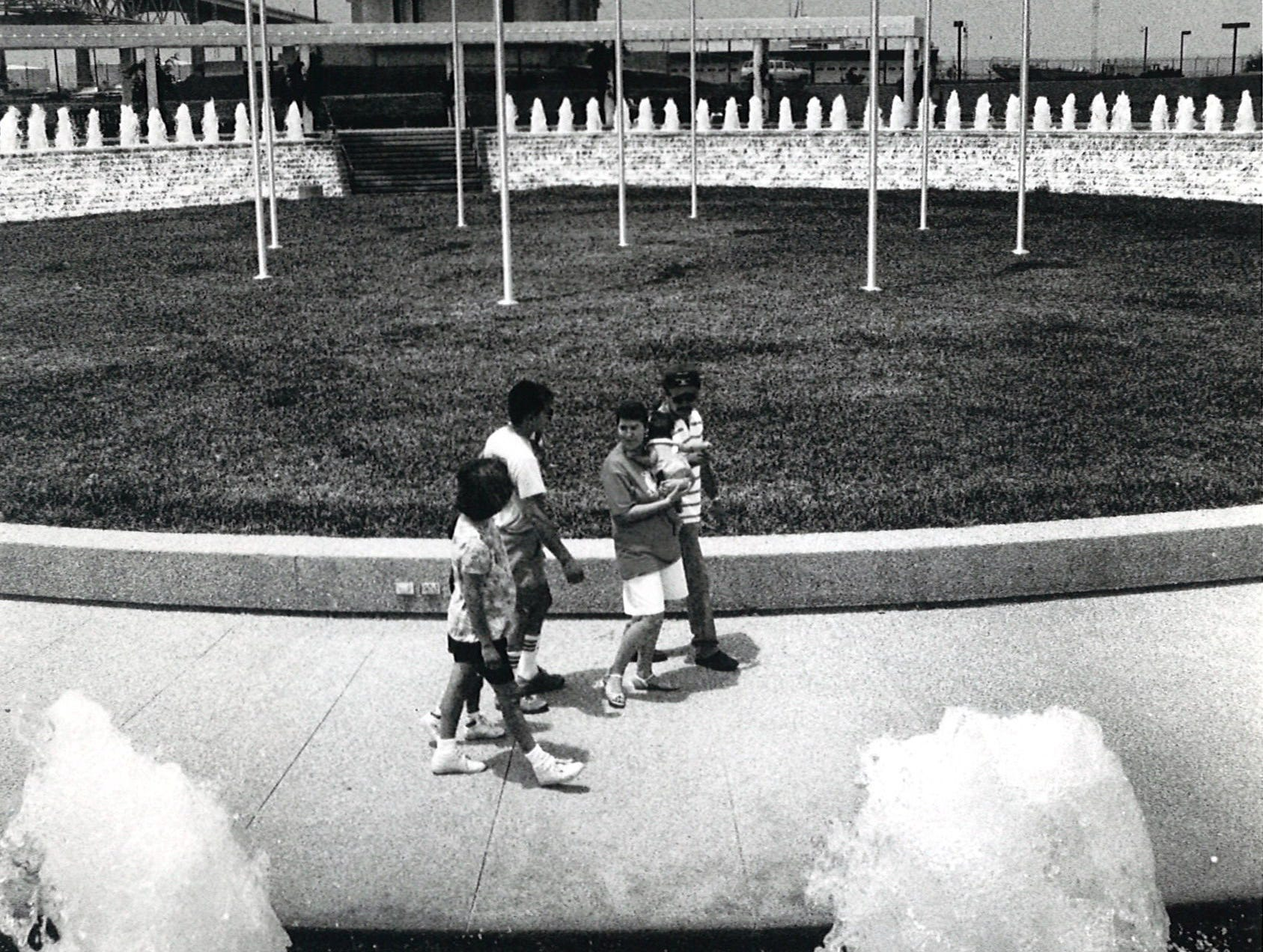Flagpoles fly the flags of each nation that supported the U.S. during the Persian Gulf War as part of a month-long exhibit at the Corpus Christi Watergarden in July 1991.