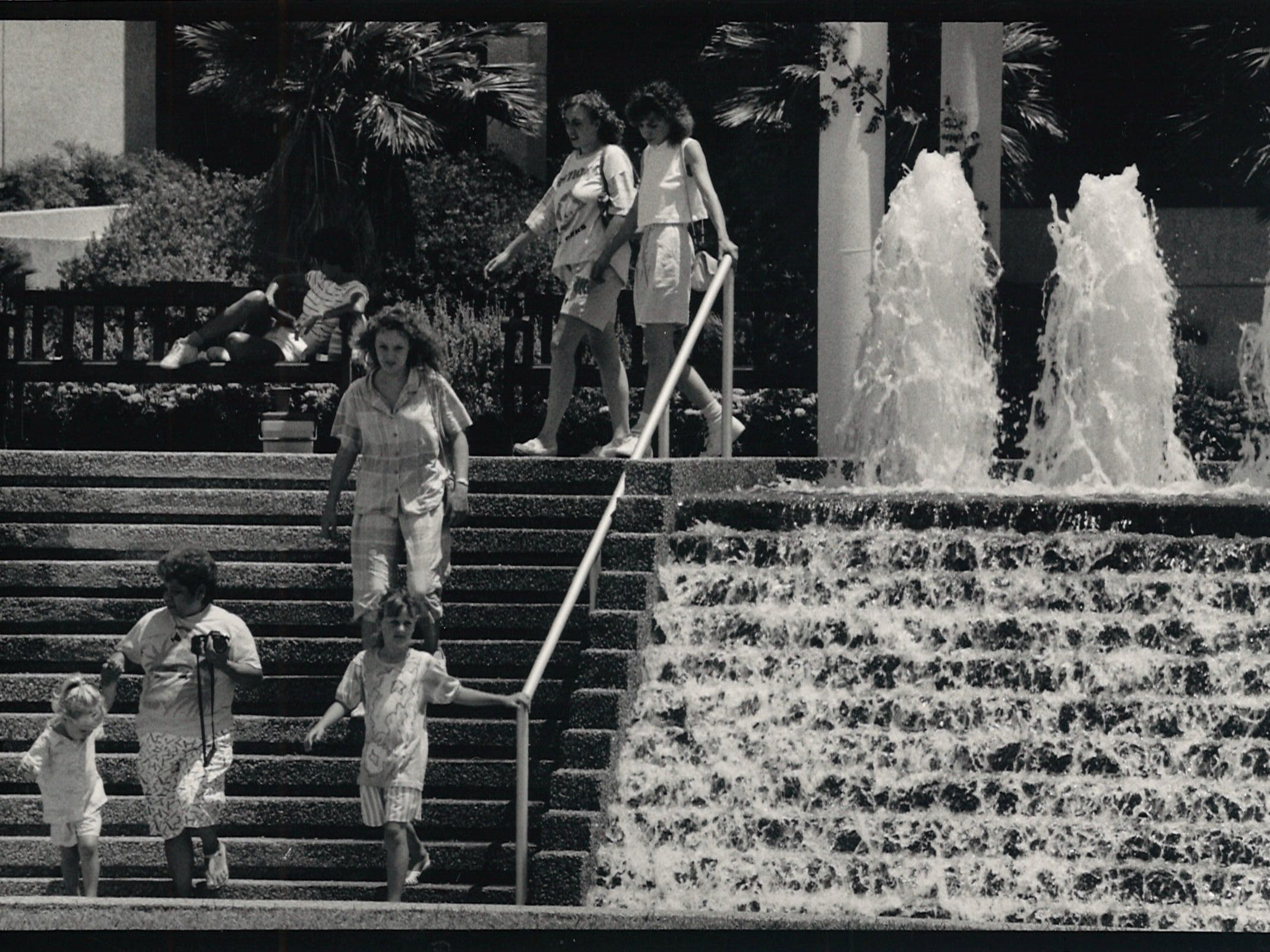 Visitors walk down the steps to the lower level of the Watergarden in Corpus Christi in July 1988.