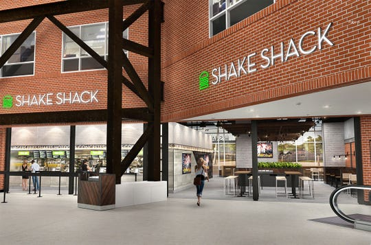 An artist rendering shows the Shake Shack planned for Citizens Bank Park as part of the new Pass and Stow fan destination area next to the Third Base Plaza. It will be the restaurant's first location inside a sports venue.