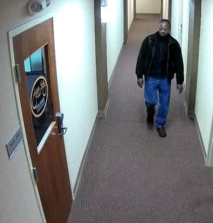 Police are searching for a man in connection with a theft from the Jeff Ruby officer in Downtown.