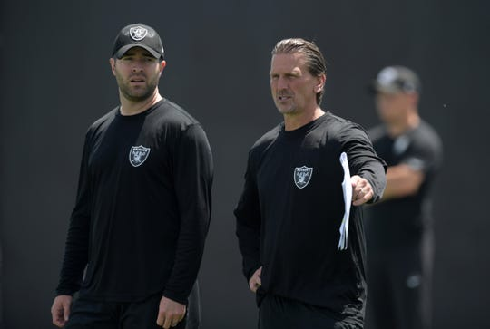 Brian Callahan (left) and Raiders offensive coordinator Greg Olson look on during an Oakland practice last year. Callahan is expected to become the Bengals' offensive coordinator next month.