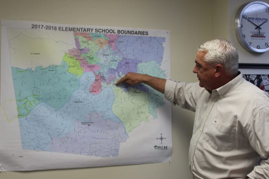 CMCSS Chief Operations Officer Jim Sumrell explains the school system's elementary school boundary lines.