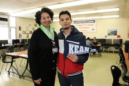 Educado Flores, valedictorian,with Vanetta Solomon, senior advisor.