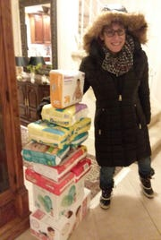 Jen-Eve Frace picked up donations of diapers for distribution tO neighbors in need through Community Development Corp.