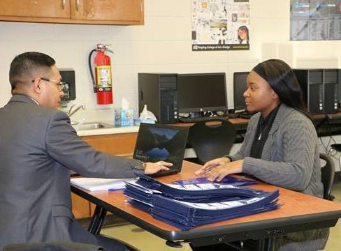 Deniesha Green and Daniel Flores, admissions counselor at Kean Univesity