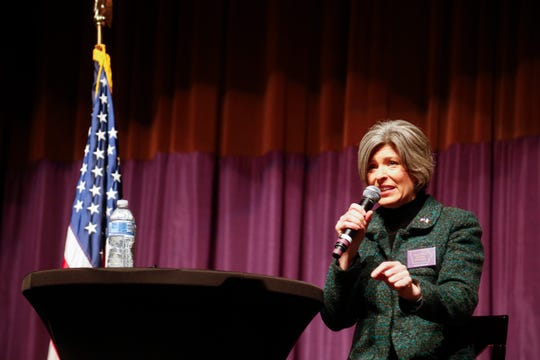 Sen. Joni Ernst, R-Iowa, takes questions during a town hall at the University of Northern Iowa Wednesday, Jan. 23, 2019.