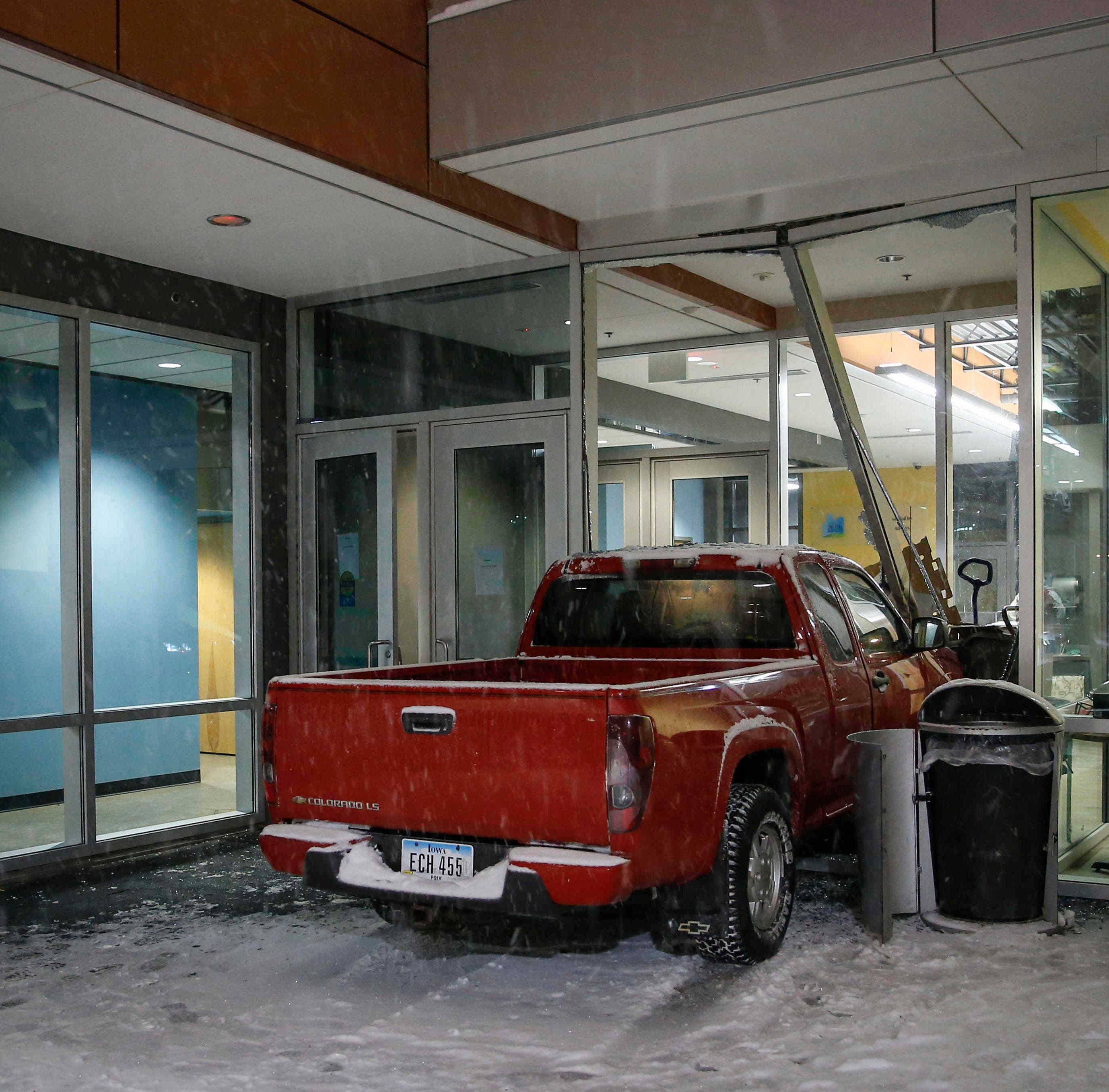 'We just heard the loudest bang': Stolen truck crashes into Des Moines homeless shelter during snowstorm