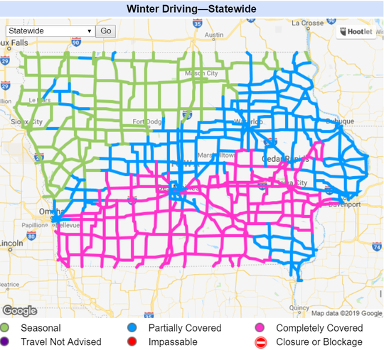 An updated look at roads in Iowa, as of 9:30 p.m. Tuesday. Pink shading indicates a road is completely covered while blue shading indicates a road is partially covered.