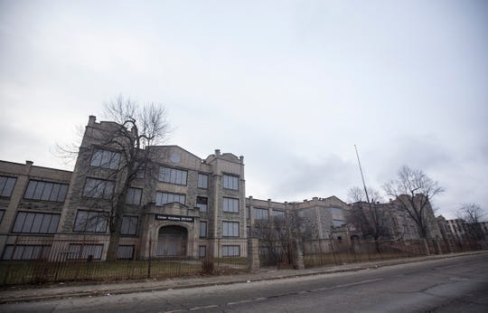 An arts entrepreneur bought several abandoned schools, including this one on Glendale Avenue in Highland Park, for his Galapagos Detroit arts center.