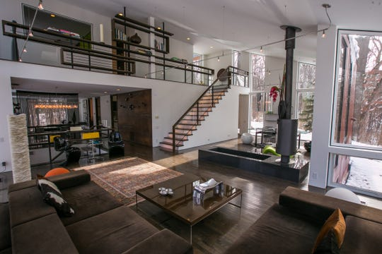 A view of the great room looking toward the second level stairway of the two-story contemporary custom-built four-bedroom home for sale in Ann Arbor Township.