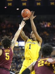 Michigan guard Charles Matthews scores Minnesota guard Amir Coffey during first half action Tuesday, January 22 , 2019 at the Crisler Center in Ann Arbor, Mich.