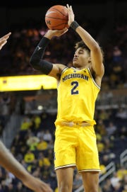 Michigan guard Jordan Poole shoots against Minnesota during the second half on Tuesday, January 22 , 2019 at Crisler Center in Ann Arbor.