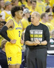 John Beilein talks with Jordan Poole during a win over Minnesota, Jan. 22 at Crisler Center.