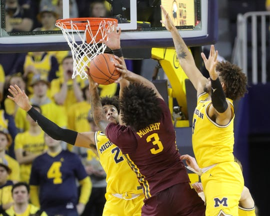 Michigan guard Jordan Poole and forward Isaiah Livers defend against Minnesota guard Jordan Murphy during the second half on Tuesday, January 22 , 2019 at Crisler Center in Ann Arbor.