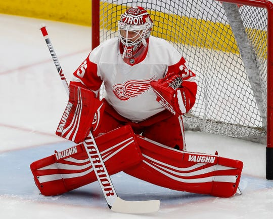 Detroit Red Wings goaltender Jimmy Howard (35) makes a save during warm up against the Edmonton Oilers at Rogers Place on Tuesday, Jan. 22, 2019.