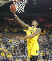 Michigan guard Charles Matthews scores against Minnesota during the second half on Tuesday, January 22 , 2019 at Crisler Center in Ann Arbor.