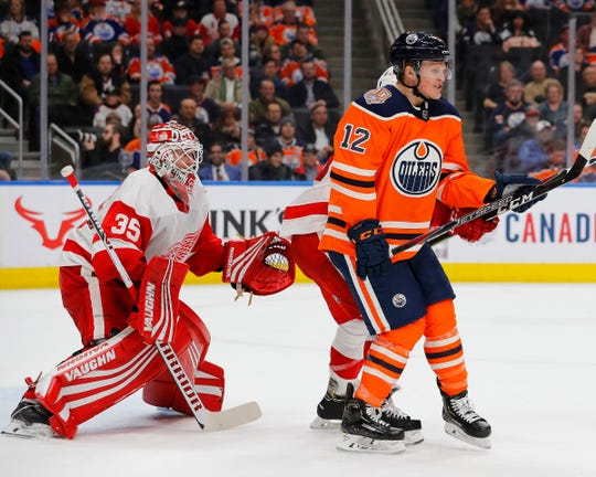 Oilers forward Colby Cave attempts to screen Red Wings goaltender Jimmy Howard during the third period of the Wings' 3-2 win on Tuesday, Jan. 22, 2019, in Edmonton, Alberta.
