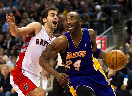 Toronto Raptors guard Jose Calderon, left, and Los Angeles Lakers guard Kobe Bryant are shown here in 2012, but Calderon was part of a defense that could not stop Bryant's 81-point outburst in 2003.