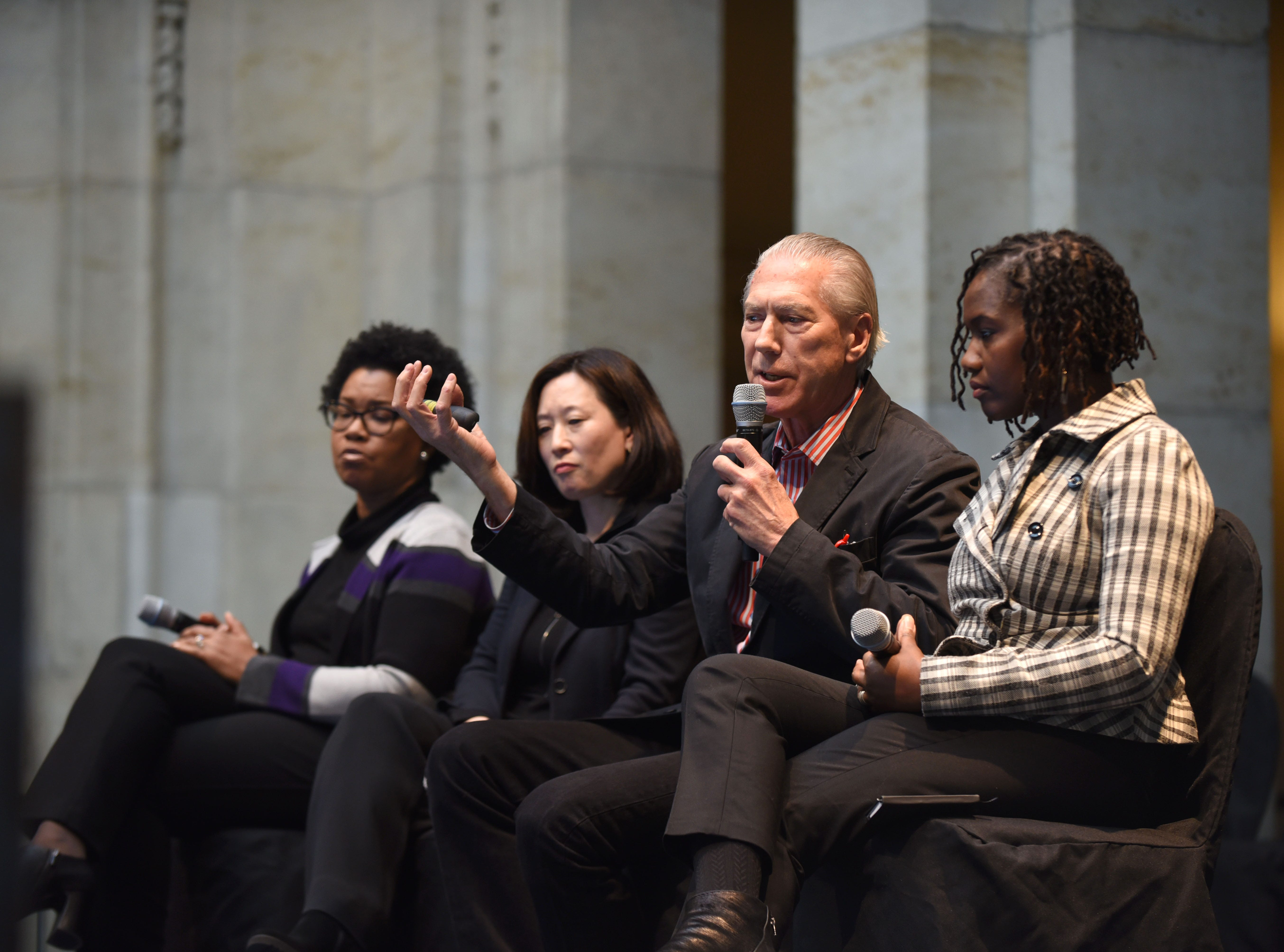 Jamie Carpenter (center) along with Sarida Scott (from left), Mikyoung Kim, and Kemba Braynon address a jury panel and members of the community for their finalist presentation for the DIA Plaza and cultural campus on Wednesday, January 23, 2019 at the Detroit Institute of the Arts.