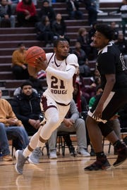 Nigel Colvin scores 21 points in River Rouge's 83-64 victory over Southfield Christian on Saturday.
