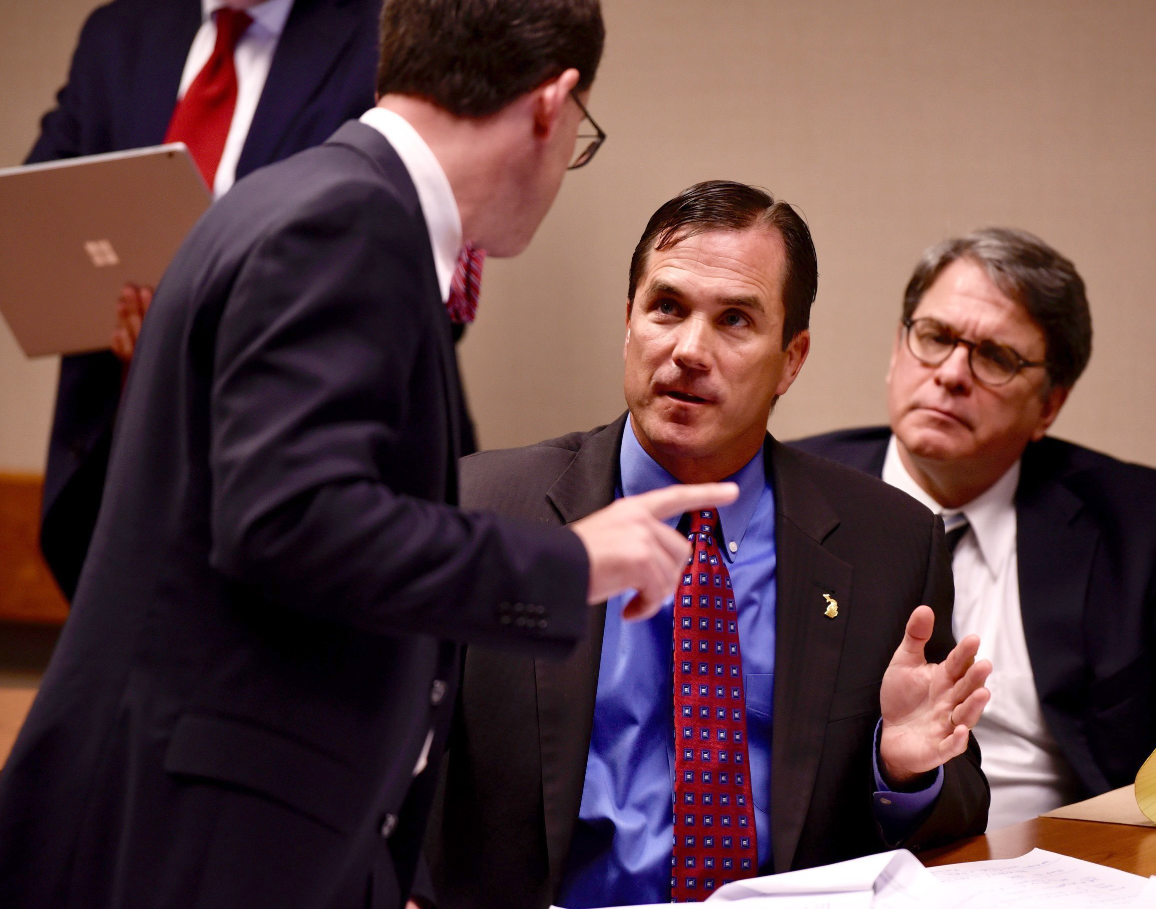 Nick Lyon, center, talks with his attorney John Bursch, left, during the hearing Wednesday.