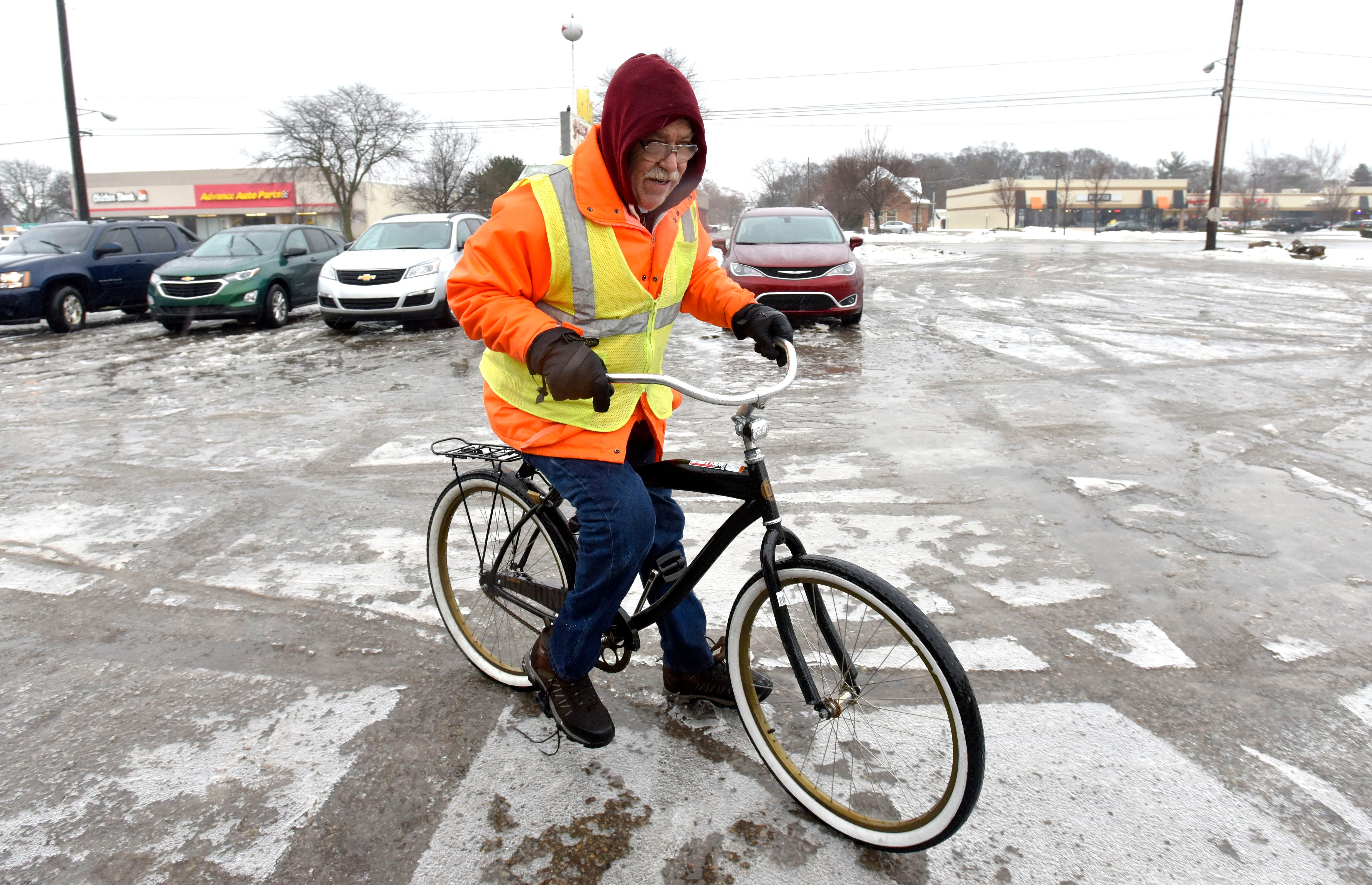 Mark 'Rocky' Szcepanski,' 62, of Shelby Twp., navigates icy sidewalks on the way to the Shelby Lanes bowling alley  Jan. 23, 2019.