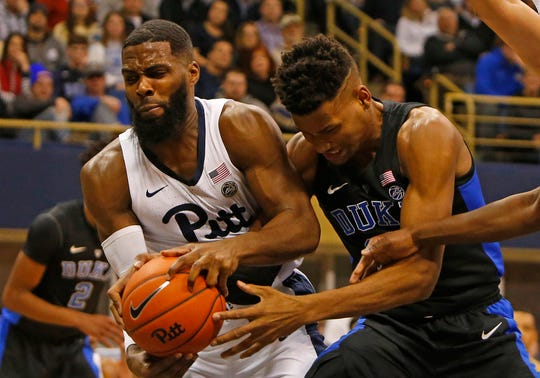 Duke's Javin DeLaurier, right, and Pitt's Jared Wilson-Frame battle for a rebound Tuesday at Petersen Events Center in Pittsburgh. Duke won 79-64.