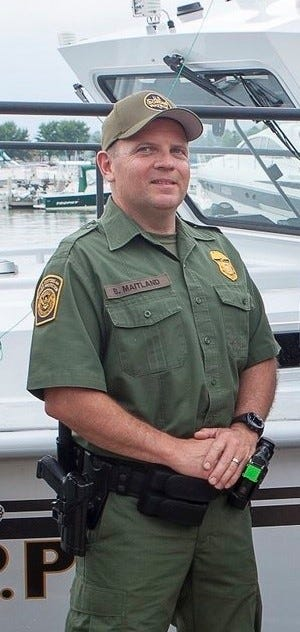 """Border Patrol Agent Brian Maitland is working without pay because of the government shutdown, but he said saving the life of a man considering suicide on a bridge in Newport, Michigan, this month was his duty. """"Anybody in law enforcement or fire or EMSwould have done the same thing,"""" he said."""