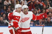 Detroit Red Wings' Luke Glendening (41) and Andreas Athanasiou (72) celebrate a goal during the third period. Glendening scored twice as the Red Wings defeated the Oilers 3-2 on Tuesday in Edmonton, Alberta.