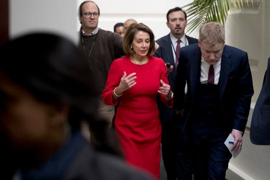 House Speaker Nancy Pelosi of Calif. arrives for a House Democratic Caucus meeting on Capitol Hill in Washington, Wednesday, Jan. 23, 2019.